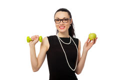 Brunette businesswoman  holding apple and dumbbells Stock Photography