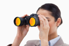 Brunette businesswoman looking through binoculars Royalty Free Stock Photography