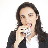 Eating pills Stock Photo