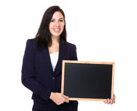 Brunette Businesswoman show with chalkboard Royalty Free Stock Photos