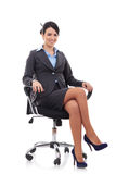 Brunette businesswoman sitting in a chair Stock Photo
