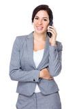 Brunette businesswoman talk to cellphone Royalty Free Stock Photos