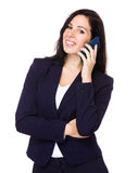 Brunette businesswoman talk to cellphone Stock Photography