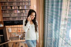 Brunette businesswoman talking on phone stock photography
