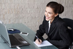 Businesswoman with teeth smile writing Stock Photos