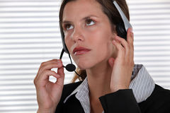 Brunette call-center worker Royalty Free Stock Image
