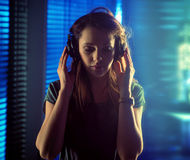 Brunette calm lady listening to music Royalty Free Stock Images