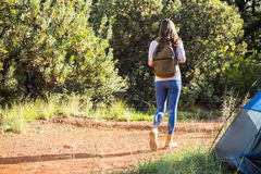Brunette camper walking away from tent Stock Images