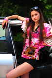 Brunette and a car Royalty Free Stock Photos