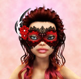 Brunette in carnaval mask Royalty Free Stock Images