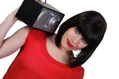 Brunette carrying radio Royalty Free Stock Images