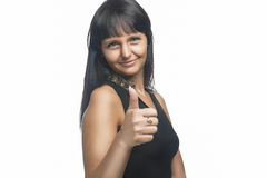 Brunette Caucasian Woman Making Thumbs Up Sign Stock Image