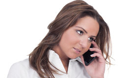 Brunette on cell phone Royalty Free Stock Images