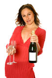 Brunette with champagne bottle Royalty Free Stock Images