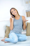 Brunette chatting on mobile Stock Photography