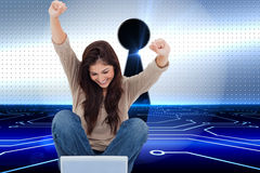 Brunette cheering while using laptop Royalty Free Stock Photos