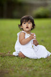 Brunette child in grass Royalty Free Stock Images