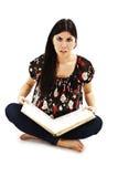 Brunette chocado precioso con un libro Fotografía de archivo libre de regalías