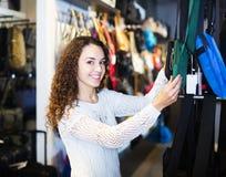 Brunette choosing bag in store Royalty Free Stock Photo