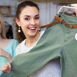 Brunette choosing  clothing in shop Stock Image