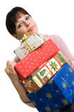 Brunette with Christmas presents. Young brunette with pile of Christmas presents isolated over white Stock Photo