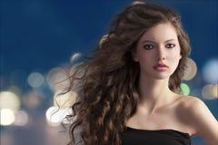 Brunette on city light bokeh Royalty Free Stock Photography