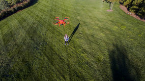 Brunette Coed Flying A Drone Royalty Free Stock Photos