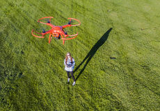 Brunette Coed Flying A Drone. A brunette coed flying a drone in the outdoors stock photography
