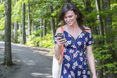 Brunette Coed Walking On Campus Royalty Free Stock Image