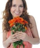 Brunette com uma flor imagem de stock