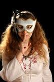 Brunette con la máscara veneciana Foto de archivo