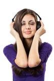 Brunette con los auriculares Foto de archivo