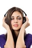 Brunette con los auriculares Imagen de archivo libre de regalías