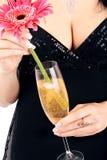 Brunette con un vetro del champagne. Immagini Stock