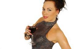 brunette con un vetro di vino Fotografie Stock Libere da Diritti
