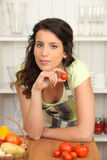 Brunette cooking in kitchen Royalty Free Stock Image