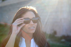 Brunette cool girl with sunglasses Stock Images