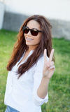 Brunette cool girl with sunglasses Stock Photos