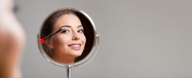 Brunette cosmetics beauty. Royalty Free Stock Photography