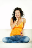 Brunette on couch Royalty Free Stock Photography