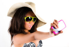 Brunette in cowboy hat, shades with phone Stock Photo