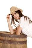 Brunette cowgirl lean on barrel look smile Stock Images