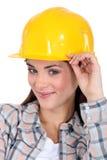 Brunette craftswoman looking mischievous Stock Photo