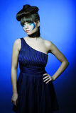 Brunette with creative make up in blue dress Stock Image