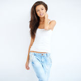 Brunette cutie posing over white Stock Image