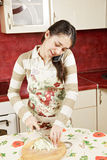 Brunette cutting cabbage on phone Stock Photos