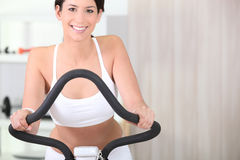 Brunette on cycling in the gym Stock Image