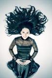 Brunette da mulher nova com cabelo preto fotografia de stock royalty free