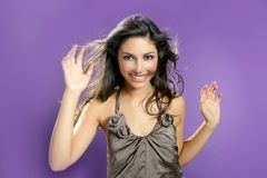 Brunette dancing at studio on purple background Royalty Free Stock Images