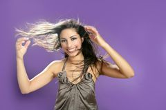 Brunette dancing at studio on purple background Stock Image